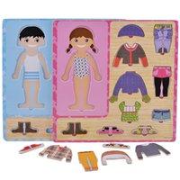 أربعة أشبال تغيير الملابس لعبة الأطفال خشبية اليد في وقت مبكر اليد استيعاب اللباس مطابقة بانوراما لغز لعب سعر المصنع بالجملة 980 v2