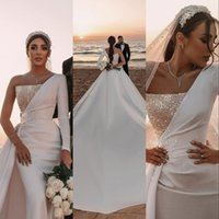 2021 Stunning Ivory Modern Mermaid Wedding Dresses Bridal Gowns Saudi Arabic Dubai Backless Overskirts Long Detachable Train Formal Sexy One Shoulder Sequins