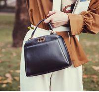 Femme Marque Peekaboo Sac shopping de haute qualité Véritable Cuir Véritable Nouveau Sac à bandoulière de mode Numéro de série Numéro de série 23 * 18cm