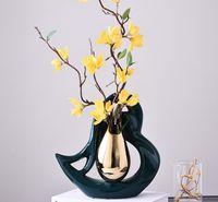 Creative corazón en forma de jarrones de cerámica de gota de oro forma de flores Arreglo de flores de porcelana hueca Flor de flor de porcelana Insertar Decoración de la casa moderna