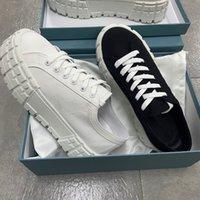 Mulheres roda plataforma de cassetes plana sneakers grosso borracha de borracha de forma de treinamento de lona lace-up sapatos de luxo sapatos casuais com caixa 261