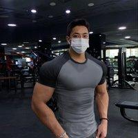 MCW фитнес колготки мужские быстросухие упражнения с короткими рукавами футболка шоу мышцы высокие упругие дыхательные братья ждать подъема обучения мы