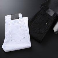 Высококачественные мужские дизайнерские роскоши джинсы черно-белые пары продано Проблемный бизнес случайные уличные носить человека брюки тонкие ноги подходят сорванные отверстия полоса известные брюки w40