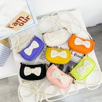 Children's bag cute pearl bow knot princess messenger bag western style girl accessories coin purse