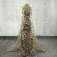 Glamrous Halter Neckline Red Carpet Celebrity Dresses Gorgeous Illusion Crystal Beaded Sheath Evening Dresses With Cape Formal Ev