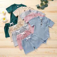 Baby Boy Girl Vêtements vêtements Set Pocket Romper Shorts 2 PCS Jumpse à manches courtes Costume Porter Summer Solid Color Outfit Tenue Pajamas Boutique