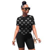 Mujeres conjuntos de verano Marca de diseño 2 piezas Conjuntos Sports Traje Camiseta Pantalones cortos SHORKOVER S-2XL MANGO CORTE JOGGER SUJEJO CAPRIS CAMISETAS CORTUCHILLO W8077