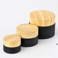 Bocons cosmétiques de bocaux en verre givrés noir avec couvercles en plastique de bois PP Liner 5g 10g 15g 20g 30g 50g emballage de lèvres DHE8645