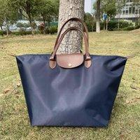 Торговые сумки нейлоновые путешествия портативный складной легкий вес водонепроницаемый спортивный мешок с кожей