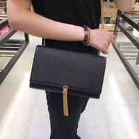 النساء المصممين المصممين حقائب 2021 الكافيار سلسلة سلسلة الجلد مصمم الأزياء حقيبة اليد الصلبة لون نقي الشرابة حقيبة crossbody الجملة جلد طبيعي بالجملة