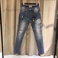 20 fashion brand MMJ skull print hole stone wash men's elastic Slim small straight jeans