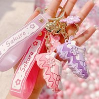 Blossom de cerezo romántico Mini zapatos de deporte 3D llaveros llaveros llavero anillo bolsa con cremallera decoración colgante para niñas regalos de primavera