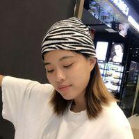 Motif de zèbre à la mode tricoté femme automne hiver hiver chaud jacquard étudiant laine polyvalente baotou chapeau de Yuppie froide