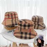 21ss Seyahat Güneşlik Kova Şapka Geniş Ağız Şapka Moda Klasik Izgara Şerit Baskı Tasarımcısı Kadın Naylon Sonbahar Bahar Balıkçı Sun Caps Bırak Gemi