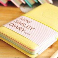 Negócios e estudantes Cute colorido mini caderno de couro de sorriso 7.5 * .12.5 cm 192 folhas ligado a fio 90g / pc Diário de moda 1338 T2