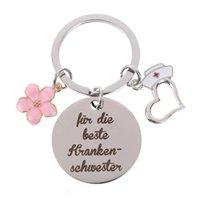 Infirmière en acier inoxydable Keychains Pendentif Fleur Creative Forme De Création Rond Keychain Décoration de bagages Clé Clé d'infirmière