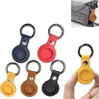 Porte-clés en cuir coloré Favoris Favoris Sac de protecteur Airtag Airtag anti-perdu Localisateur de porte-clés tout compris, emballé individuellement petit cadeau