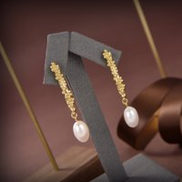 2021 new fashionable golden pearl earrings simple fashion earrings high-end brass electroplated 18k gold unique styling leisure temperament