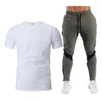 Наборы беговых наборов летней моды досуг бренда мужской набор персонализированные спортивные футболки с короткими рукавами + случайные брюки