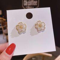 S925 Pure Sier Température Elegant Camellia Fleur Super Fairy Simple Advanced Sign Insère Boucles d'oreilles françaises