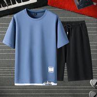 Men's Tracksuits Men Moda T-shirt Abiti Solid Falso Due pezzi Set Set Tshirts + Sweatpants Summer Sportswear Sportswear Tuta maschile