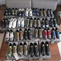 Designers Camouflage Sneakers Hommes Femmes Chaussures Rivet Plateaux Casual Chaussure Casual Camo Camo Cuir Entraîneurs Rockrunner Chaussures