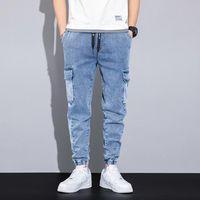 الربيع الصيف أسود أزرق فضفاض جينز الرجال الشارع الشهير متعدد الجيوب البضائع السراويل ركض جان بنطلون زائد الحجم 6xl 7xl 8xl الرجال