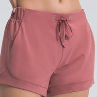 Yoga Shorts Outfit da donna Ambientazione amichevole da donna Nude Lady Pure Color Colore Tempo libero Formazione Fitness Asciugatura rapida Pantaloni traspiranti Pantaloni Primavera ed Estate L-39L