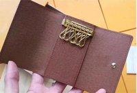 Porte-clés portefeuille de portefeuille de portefeuille véritable mode de mode enveloppe boîte de voiture unisexe case poche poche de luxe poche Pochette accessoires CLES Carte