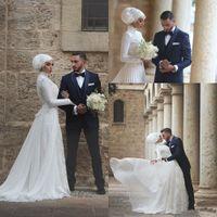 Vestidos de novia musulmanes de la boda una línea de alta joya cuello de manga larga Sweep Train Modest vestidos de novia botón cubierto 2015 vestidos de novia de encaje