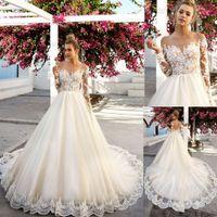 Eye-llamativo aplazamiento de encaje de festoneillos románticos vestidos de novia con mangas largas Vestido nupcial de champán con ilusión vestidos de espalda