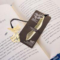 Creative Golden Marcadores con tarjeta Metal Libro Mark Elegant Paper Clip Markers Feather Angel Papelería Oficina Suministros Escolares 122342