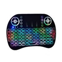 Mini 2.4GHz teclado retroiluminado inalámbrico de mano portátil con teclados retroiluminación Touchpad para PC / Smart TV / Android TV Box 1pcs / lot