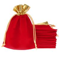 Comercio al por mayor 25 Unids 12x15 cm Red Velvet Gold Trim Cordón Regalo de la joyería de Navidad / Cadena de la boda Bolsas de lazo Bolsas decoración del partido