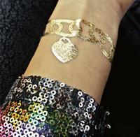 Tatuajes de oro de plata del tatuaje tatuajes temporales tatuajes de metal de oro de lujo edición limitada adhesivo de oro etiqueta engomada del tatuaje