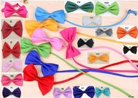 50pcs / Lot Новое прибытие Pet Dog Neckties Bowtie Wholesale Mix 10 Color Polyester Cute Dog Bow Tie Dog Grooming Products Домашний головной убор для домашних животных