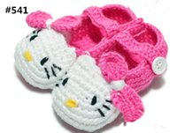 hand crocheted pink hello kitty cat baby booties with wooden...
