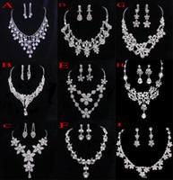 Joyas de cristal nupcial Accesorios de boda Conjuntos Dos piezas Color plata En stock Rhinestone Wedding Dress Collar Pendientes 2015