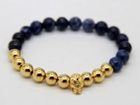 2015 حار بيع جديد تصميم المجوهرات بالجملة أعلى جودة 8 ملليمتر الأزرق الوريد ستون الخرز ريال مطلية بالذهب البرونزية اليوغا الجمجمة أساور