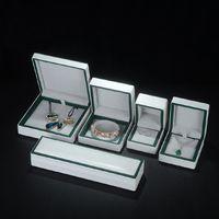 Muhteşem takı ambalaj kutusu beyaz yeşil kenarları ile düğün hediyesi kolye yüzük bilezik mücevher sunum kutusu pu deri lüks