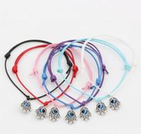 Caliente ! 50pcs Hamsa mano de perlas mal suerte de ojos color mezclado cuerda de la cera pulseras espirituales Protección éxito