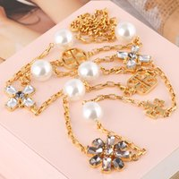 brass material 2. 2cm crystal diamond and pearl bead in 1. 5cm...