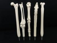 5pcs / lot 크리 에이 티브 볼 포인트 펜 뼈 모양 쓰기 용품 간호사 닥터 학생 교사 문구 선물에 대 한 뼈 모양 볼펜
