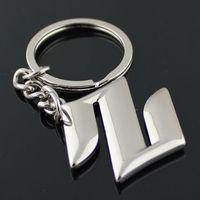 5pcs / lot Mode Suzuki Logo Voiture Porte-clés Porte-clés Suzuki Emblèmes 3D Évider Clé De Voiture Fob Auto Pièces Pour Suzuki Swift SX4 Grand Vitara