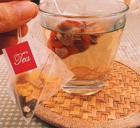 100 قطعة / الوحدة 5.8 * 7 سنتيمتر الهرم أكياس الشاي مرشحات النايلون تيباج سلسلة واحدة مع التسمية شفافة أكياس الشاي الفارغة