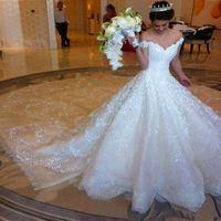 Gorgeous Off Shoulder Vestidos de novia Cristalino de cuentas Lentejuelas Apliques de encaje Vestidos de novia Una línea Tren de la catedral Vestidos de novia de encaje blanco