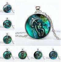 JLN Doce Constelaciones del Zodiaco 12 PCS / LOT Moda Horóscopo Tiempo Gems Cabochon Alloy Colgante Collar Regalo para Hombre Mujer