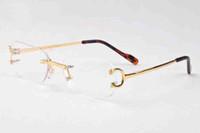 nouveaux sports de mode lunettes de soleil les deux sexes appliquent des verres des lunettes de corne de buffle l'attitude des lunettes de soleil d'or d'argent sans cadre en métal clair avec la boîte
