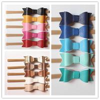 2016 Nouveau PU cuir texture simili cuir Bows Bandeaux bandes élastiques en nylon Nouveau-né bébé Bandeaux 15pcs / lot