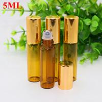 Mini 5ml Brown Ambre en verre Roll On Bouteilles Huile essentielle de parfum avec Roller Ball en acier inoxydable et or gros Cap 1100Pcs / Lot